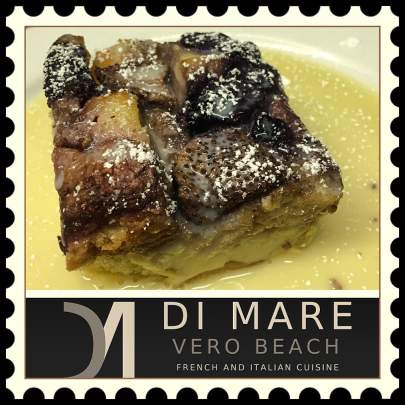 The Di Mare Vero Beach Dulce de Leche Bread Pudding is complemented and completed with Blueberries, strawberries, white chocolate, coconut and dark rum topped with a Caramel sauce, then a dash of powdered sugar.