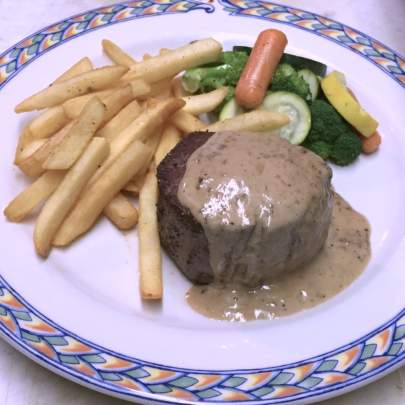 The Filet Mignon au Cognac at Di Mare Vero Beach is a pan seared, eight ounce, center cut tenderloin of Black Angus beef. Topped with a Cognac cream sauce, then served with Truffle fries and a vegetable medley.