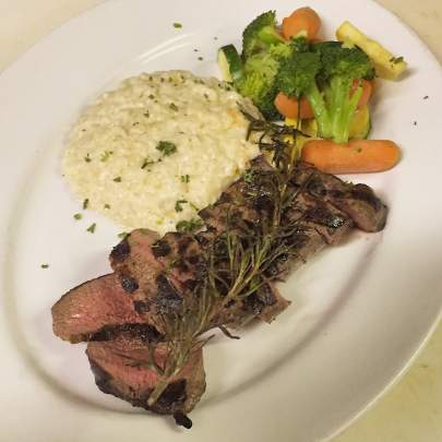 The Lamb au Porto from Di Mare Vero Beach is centered around a grilled tenderloin of savory Australian Lamb topped with a sweet Port wine glaze, served with a delicious creamy risotto and a fresh vegetable medley.