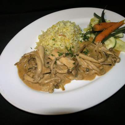 The Veal Forrestierre is four scallopini of  tender veal sauteed in a creamy Cognac sauce with Exotic mushroom, served with wild rice and sauteed vegetables