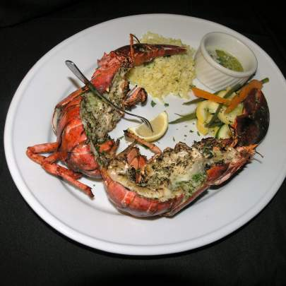 Live Maine lobster ( two pounds) baked with a Bourguignon butter, served with rice and vegetables