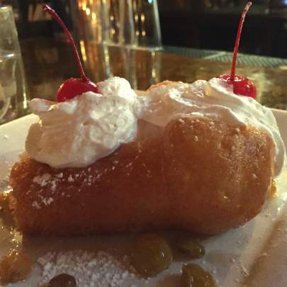 At Di Mare Vero Beach, the Baba au Rhum starts with a rum sponge cake filled with a sweet ricotta cream filling and rum raisins, that is then topped off with fresh whipped cream, powdered sugar and a few cherries on top!