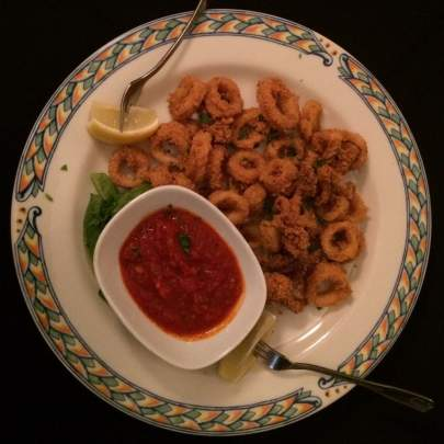 Calamari Fritti: Fresh tender rings fried served with a spicy Marinara
