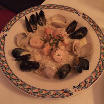 The Risotto Di Mare is a delectable mix of Jumbo shrimp, sea scallops, Virginia clams and mussels sauteed in a light Chardonnay cream sauce over risotto. A stellar seafood dish at Di Mare Vero Beach that is such a favorite, we put our name on it!